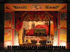 What if my set felt like a Victorian toy theater---everything highly stylized, one-dimensional with rich, saturated colors?