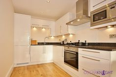 Fully fitted kitchen with fridge/freezer, dishwasher, eye level oven, hood and microwave | Please call Oscar Knight Estate Agents on 0208 823 0744 to arrange a viewing #london #chiswick #apartment #flat #kitchen