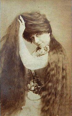 Grace Sutherland with her five feet long, auburn mane. All of her life she was very proud of it. She never married and lived until 1946. The Seven Sutherland sisters were a group of singing women from Niagara, New York, famous for their very long hair.