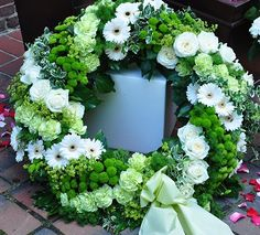 Round wreath green / white worked in stripes, may green bow . Funeral Floral Arrangements, Flower Arrangements, Easter Wreaths, Holiday Wreaths, Grave Decorations, Funeral Tributes, Cemetery Flowers, Sympathy Flowers, Funeral Flowers