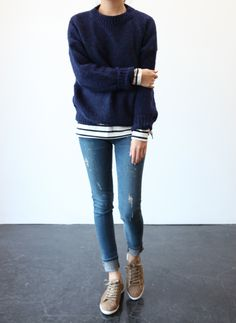 layered navy sweater / stripes / distressed denim / sneaks