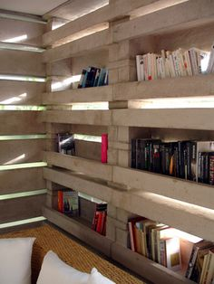 The concrete structure becomes shelf for books & whatever needs to be stowed away.