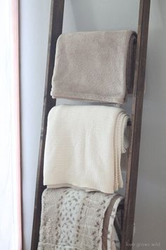 Step one: lean ladder against wall. Step two: put blankets on ladder. You got this. More directions here.