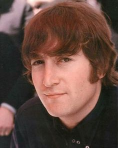 John Lennon ...  a moody-looking genius