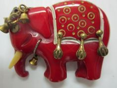 BEAUTIFUL RED ELEPHANT WITH BRASS DEEPLY CARVED BAKELITE BROOCH