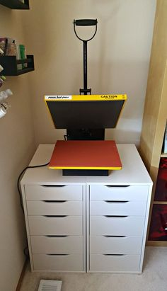 Heat Press & Vinyl Storage from IKEA The IKEA Alex Drawers are the perfect multi-purpose solution for storing both vinyl and the heat press. Keep your craft area neat and organized! Ikea Craft Room, Craft Room Storage, Craft Organization, Storage Ideas, Ikea Vinyl Storage, Small Craft Rooms, Craft Room Decor, Cricut Craft Room, Storage Hacks