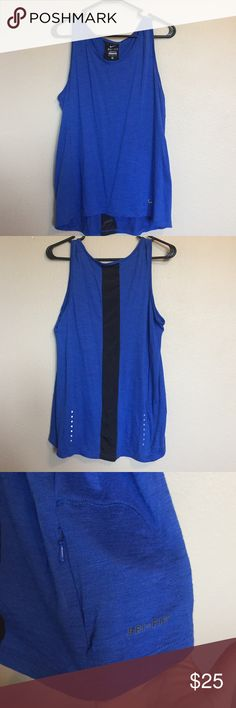 Nike Dri-Fit Tank Cobalt blue and black Nike tank. Has a storage pocket in the back and reflective spots. Very lightweight Nike Tops Muscle Tees