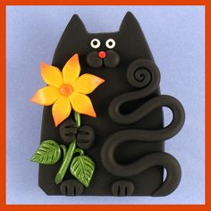 Sunflower Kitty Cat Pin  I think this would make a cute yard ornaments.