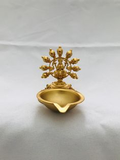Full gold Lakshmi print small deepam Handmade jewelry Silver plated jewelry One gram jewelry 3 inches height 6 inches length Brass Diyas, Nizam Jewellery, Diwali Decorations At Home, Silver Pooja Items, Pooja Room Door Design, Pooja Rooms, Indian Home Decor, Brass Material, Plant Decor
