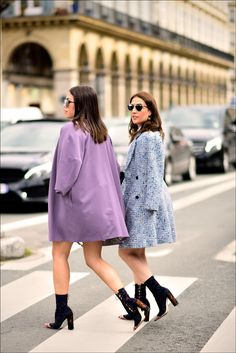 Draped coats on the street at the Dior fashion show in Paris during Paris Fashion Week, Ready to Wear Fall/Winter 2016/2017 on March 4, 2016