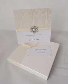 Boxed wedding card in ivory and white with flock paper and crystal decoration, available in other colours too
