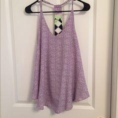 """Cute top!!! Tyche brand. Size Medium. It is really flattering on as it is a """"V"""" cut neckline and is loose on the bottom. Depending on the torso length is will hit mid to low hip - perfect for fitted bottoms. The back is cute with a splash of contrasting color!! Excellent condition. Tyche Tops Camisoles"""