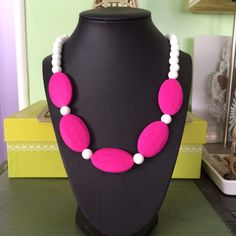 Hot pink faceted beads teething necklace Cute design. NWOT. Made from silicone good grade beads. Perfect accessory for mom yet great teething you for baby. Always supervise children while using teething necklace Boutique 9 Jewelry Necklaces