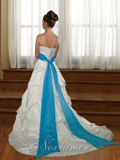 Not this style, but a white dress with light blue waist ribbon. Maybe a little more natural toned blue- sky, aqua.... To match the natural toned green