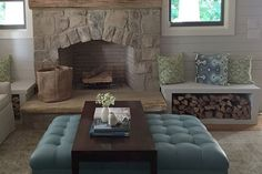 """Great examples of versatile, multi functional seating - love how nicely the wood storage """"benches"""" frame the fireplace for extra charm"""