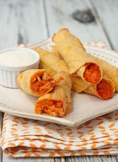 These Buffalo Chicken Taquitos will give your Taco Tuesday a spicy Buffalo twist all wrapped up in a crispy corn tortilla - just 119 calories or 2 Weight Watchers points each! www.emilybites.com