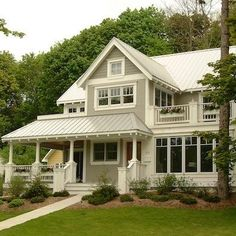 Taupe with Taupe Roof/Cream accents  8 Exterior Paint Colors That Might Help Sell Your House