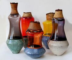 Image from http://3.lushome.com/wp-content/uploads/2014/04/metal-glass-vases-decor-accessories-stacking-vessels-3.jpg.