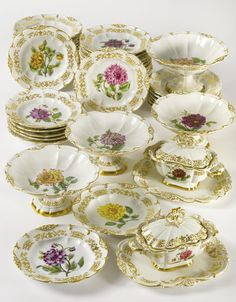 AN ASSEMBLED PARIS PORCELAIN BOTANICAL PART DESSERT SERVICE CIRCA 1830-40. comprising four footed circular compotes, two sauce tureens, covers and fixed stands and thirty-nine dessert plates, thirty-two with printed retailer's marks in red. 47 pieces.