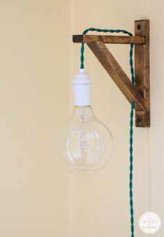 This quirky sconce is a quick DIY project for a space that needs a little more light. Courtesy of Inspired By Charm.