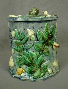 THOMAS SERGENT circa 1870 French Palissy Ware tobacco jar highly decorated with leaves, shells and snail finial.