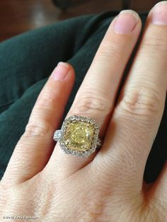 Kelly Clarkson's photo: Everyone has been asking about my engagement ring, so here it is :) It's a yellow canary diamond with diamonds around it and Brandon designed it with Johnathon Arndt! They did an amazing job! I can't wait to make Brandon's ring with Johnathon as well!