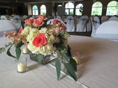 Coral, Peach, & White Wedding Centerpiece:: White Hydrangea, Amsterdam Roses, Peach Stock, Peach Spray Roses, Thistle :: The Vines Flower & Garden Shop