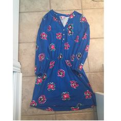 Lilly Pulitzer dress Lilly Pulitzer dress size medium, it has been hemmed to fit someone who is 5ft one. This dress is super flowly and made of the softest material. Worn only twice! Lilly Pulitzer Dresses