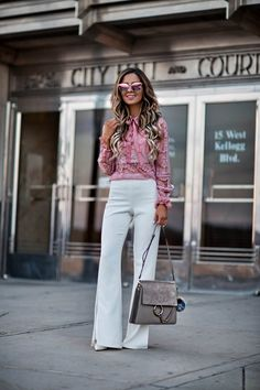 mn fashion blogger mia mia mine wearing a pink lace top from shopbop and white pants from revolve