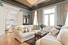 the wall colors along with the darker trim at the ceiling and the creamy pale linen on the furniture and doors make for a beautiful soothing room