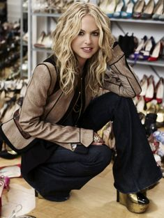 Rachel Zoe's jacket and shoes are Louis Vuitton, jeans are Seven For All Mankind, and jewelry is vintage.