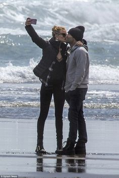 Cute couple: Rosie Huntington-Whiteley and fiance Jason Statham put on an adorable display on Wednesday as they cosied up at Piha Beach on Auckland's West Coast, New Zealand