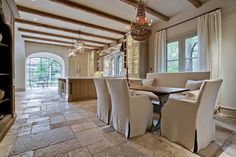 <3tone on tone :: view 4 of 5 :: <3this dining space; lighting, table, window treatments & open/bookcase style cabinetry for stoneware...