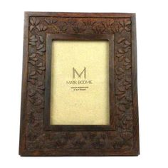 Hand carved in India from rosewood with a botanical design, this 8 X 10-inch frame with glass covering the photo opening has easy-to-use hinges for removing the back. With a wood easel back for standing and a hook for vertical hanging, the frame holds a 4x6 photo.