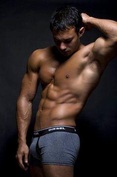 Manly muscular male sucks stiff cock