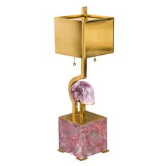 Amazing Carved Amethyst Skull Table Lamp  USA  20th C.  This is an exquisite lamp with touch sensor on/off command through the brass components of the lamp. Double sockets and a carved amethyst skull.
