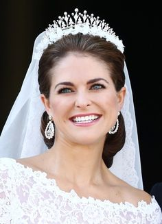 STOCKHOLM, SWEDEN - JUNE 08 2013:  Princess Madeleine of Sweden appears on the balcony after the wedding ceremony of Princess Madeleine of Sweden and Christopher O'Neill hosted by King Carl Gustaf XIV and Queen Silvia at The Royal Palace on June 8, 2013 in Stockholm, Sweden..... She was such a beautiful bride!!