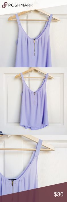 """*donating May 1* 🦄 Lilac Tank Perfect little lilac tank feature chiffon front and t-shirt material back. Gold zipper runs down the front and the tank has about 1"""" thick straps. Light and breezy material and the color is stunning! 🦄 Never worn, I have this in bright coral pink too. Express Tops Tank Tops"""