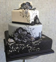 "3 tiered black, white and gray cake with ""fabric"" flowers, quilting and ribbon ... by Sugar CoutureBy Over the Top Cakes"