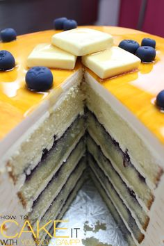 Vanilla cake with maple-infused buttercream, and blueberry jam. Wrapped in handpainted buttercream pancakes. Fondant butter pats and blueberries on top! #Cakes #Dessert #Baking