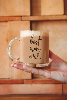 "You love mom, mom loves coffee. You'll both love this glass coffee mug with ""Best Mom Ever"" printed on the side. Every time she uses this modern mug she'll think of you. Modern Mugs, Modern Glass, Plain White Mugs, Glass Coffee Mugs, Mom Mug, Christmas Gifts For Mom, Love Mom, Ceramic Mugs, Best Mom"