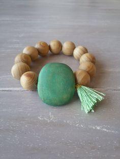 Natural wooden bead necklace with green tassel and big flat green wooden bead- elastic bracelet - stacking bracelet - boho bracelet by MerakibyStevie on Etsy