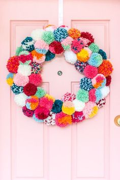 Make a Bright and Colorful Boho Holiday Pom-Pom Wreath - DIY - Decoration Pot Mason Diy, Mason Jar Crafts, Pom Pom Wreath, Pom Poms, Diy Home Decor Projects, Diy Projects To Try, Decor Crafts, Wreath Crafts, Wreath Ideas