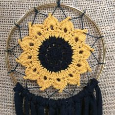 Sunflower Dream Catcher This dream catcher is created on a 5 inch ring and hangs around 1 foot 4 inches long. They are made with handmade sunflower doilies and your choice of fabric or feathers. NOTICE: each dream catcher varies slightly Dream Catchers For Sale, Dream Catcher Craft, Dream Catcher Boho, Sunflower Crafts, Crochet Sunflower, Crochet Flowers, Granny Square Crochet Pattern, Crochet Patterns, String Crafts