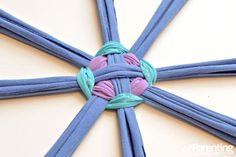I am thinking of helping my students to create this Hula Hoop Rug! It looks like a great way to develop motor skills, learn to work cooperatively, and develop an understanding of patterning.