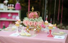 Pretty Centerpieces - love individual cupcakes on painted candlesticks and pretty plates
