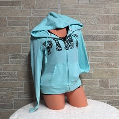 🛍Limited Edition Black Friday Hoodie New without tags, I washed it 1X and never wore it! teal Abstract lettering and Full Zip Hoodie In supersoft fleece Print graphics on front Drawstring hood Side pockets Imported cotton/polyester.💟ANIMALS LIVE HERE💟 •{May not get every single hair off item} 🚭Smoke Free Home 🚫No lowball offers  😑{Example: $30, but you offer $15}😑 🚫Drama / Rude Free  💔No More Holds 🤐Don't ask me to use Mercari 📌Prices are Firm {Posh Takes 20%} ❓Any Questions…