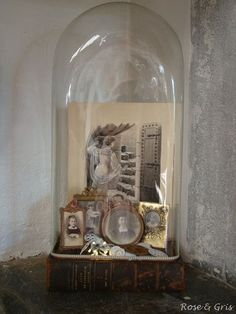 cloche...interesting way to display heirloom pics & trinkets