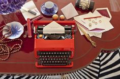 Kelly Wearstler Residential #kellywearstler #interiordesign #luxuryinteriors #lifestyle #decor red lacquer desk detail #colorfurniture