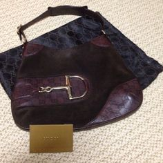 Gucci handbag PRICE FIRM Brown suede and leather Jackie O Gucci handbag with gold hardware and the famous horsebit on front of bag and horsebit lining.  This bag is been only used a few times, comes from pet and smoke free home.  No rips, stains or tears perfect condition. 100% authentic Gucci bag comes with original control card and dust bag.  Handbag has always been kept in dust bag. Gucci Bags